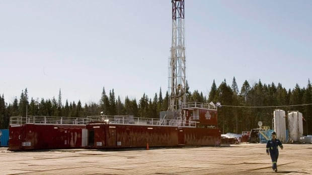 A new Quebec report says shale gas could pose harm to the environment. A Talisman Energy worker is seen here walking from a shale gas drilling rig in Saint-Edouard-de-Lotbiniere, Que.