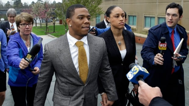 Ray Rice of the Baltimore Ravens holds hands with his wife, Janay Palmer, as they arrive at Atlantic County Criminal Courthouse in Mays Landing, N.J., on Thursday.