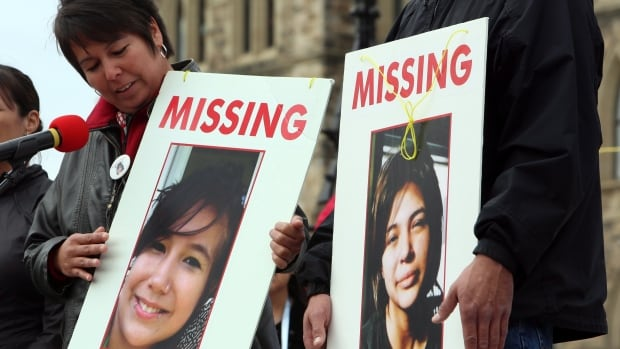At a rally last year, Laurie Odjick holds a sign with photo of her missing daughter, Maisy, who went missing along with Shannon Alexander in 2008 at age 16. Today, families of missing women gathered to call for a national inquiry into missing and murdered indigenous women.