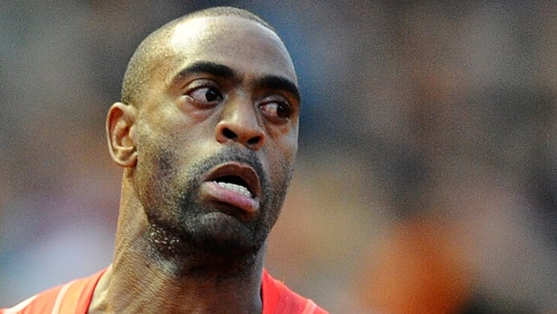 American sprinter Tyson Gay, shown in this 2013 file photo, was banned for a year by the USADA on Friday.