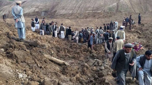 Afghans search for survivors after a massive landslide landslide buried a village Friday, in Badakhshan province, northeastern Afghanistan, which Afghan and UN officials say left hundreds of dead and missing missing.