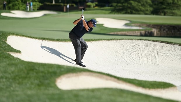 Angel Cabrera blasts out of a bunker in the second round of the Wells Fargo Championship at Quail Hollow Club on Friday.