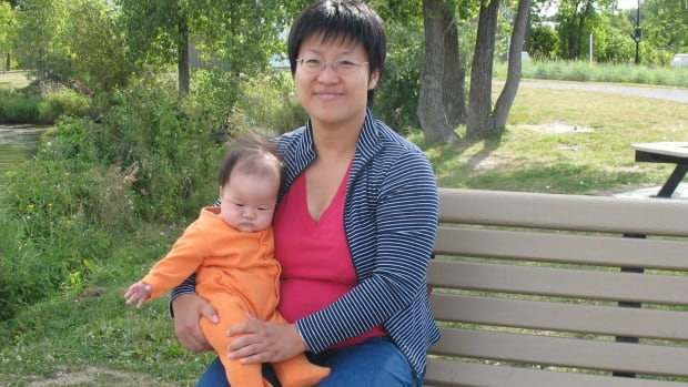 Jian Ping Li and one of her children.