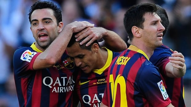 FC Barcelona's Alexis Sanchez, second left, celebrates scoring against Getafe with his teammates Xavi Hernandez, left, and Lionel Messi, during a La Liga match in Barcelona on Saturday.