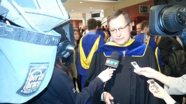 Former Alberta premier Ed Stelmach speaks to reporters after receiving an honorary degree from NAIT at convocation in Edmonton on Saturday.