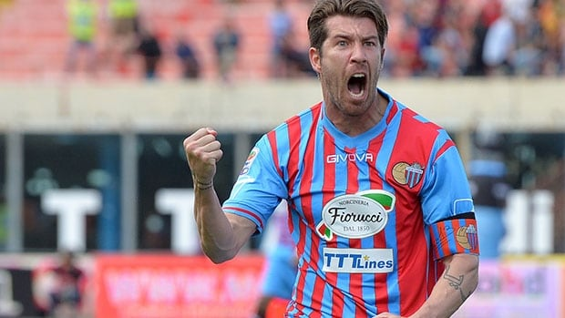 Catania midfielder Mariano Izco celebrates after scoring Sunday against Roma, whose loss gave Juventus its 30th Serie A title.