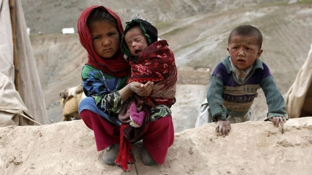 Displaced Afghan children sit outside their tent near the site of a landslide at the Argo district in Badakhshan province May 4, 2014.