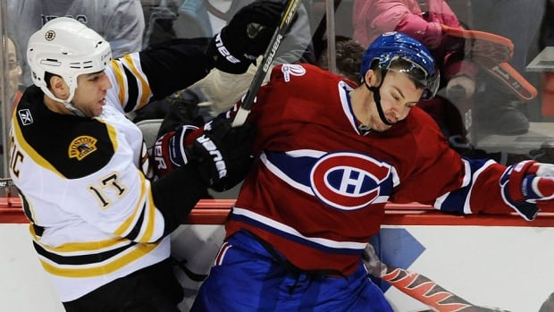 """Canadiens defenceman Josh Gorges, right, says he and his teammates must do a better job of getting on the puck first when they face Boston on Tuesday night in Game 3 of their NHL Eastern Conference semifinal. """"Even if they get to the puck, we've got to try to stop their cycle, eliminate it right away and get the puck moving,"""" he says."""