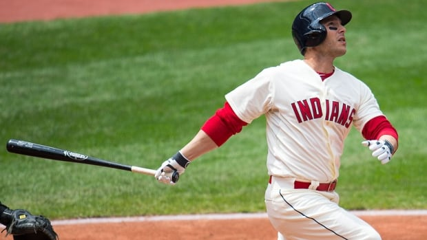 Indians catcher George Kottaras hits one of his two home runs on Sunday, a solo shot in his first major league at-bat of the season in the third inning against the White Sox, who won the game 4-3.