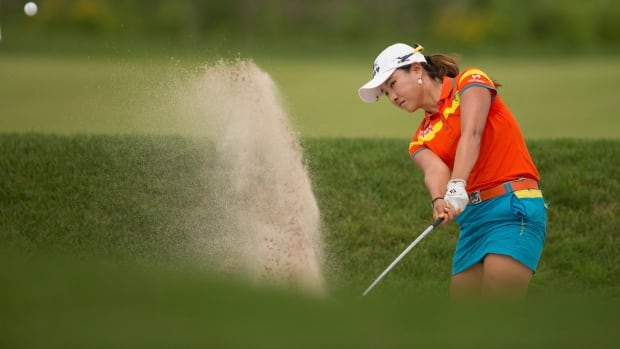 Hee Young Park of South Korea hits out of a bunker on the 10th hole during the final round of the Manulife Financial LPGA Classic at Grey Silo Golf Course in Waterloo, Ontario, last July on her way to capturing the 2013 title.