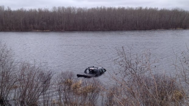 RCMP are investigating this vehicle, discovered submerged in water. They think it may have been stolen and parked on winter ice.