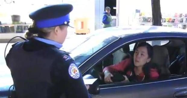Parking officer grills driver