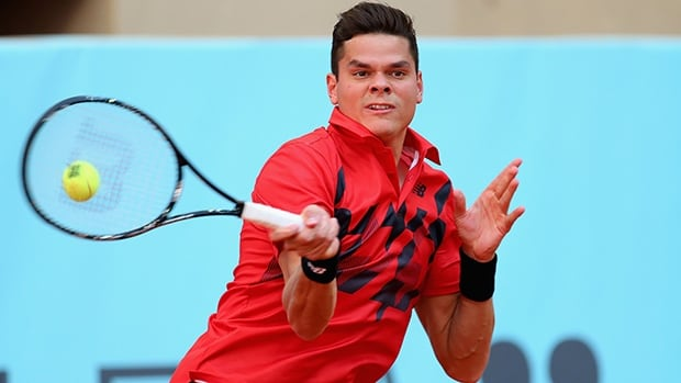 Canada's Milos Raonic plays a forehand against Jeremy Chardy of France in their second round match at the Madrid Open tennis tournament on Tuesday in Madrid, Spain.
