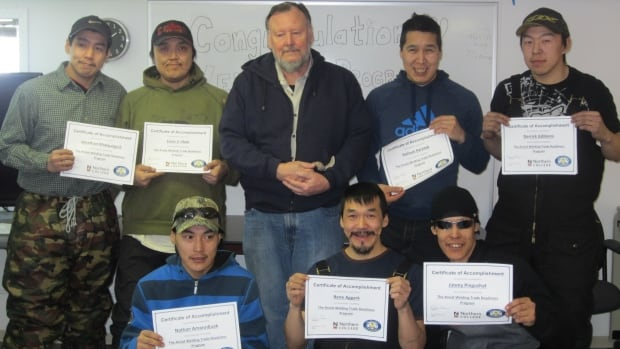 Seven people, including Renee Aggark (centre front), recently graduated from Arviat's first eight-week welding trade readiness course.