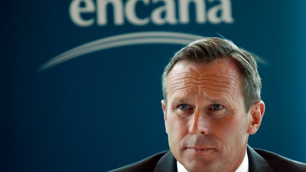 Doug Suttles, CEO of Encana Corp., speaks to reporters in Calgary in 2013. The Calgary-based company announced on Wednesday it's planning a further 20 per cent reduction in its workforce to achieve up to $250 million in additional cost savings this year.