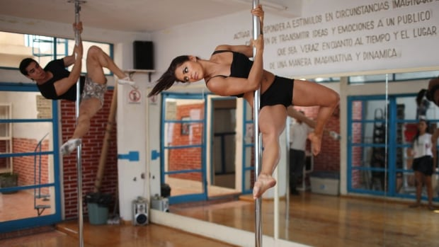A woman who suffered a concussion last year while hanging upside down from a pole is asking people to be wary of pole dancing style exercises.