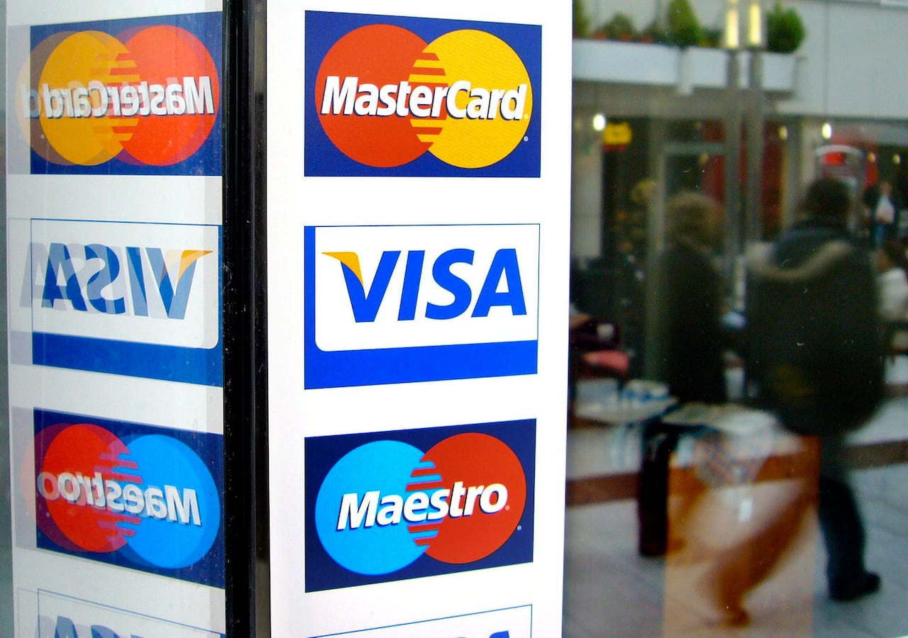Visa, MasterCard agree to hold interchange fees at 1 5% for