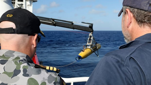 The Phoenix International Autonomous Underwater Vehicle (AUV) Artemis is craned over the side of Australian Defense Vessel Ocean Shield before launching in to the southern Indian Ocean in the search of the missing Malaysia Airlines Flight 370.