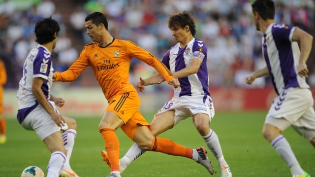 Cristiano Ronaldo and Valladolid's Alvaro Rubio, right, challenge for the ball at the Jose Zorrilla stadium in Valladolid, before the Real Madrid star left.