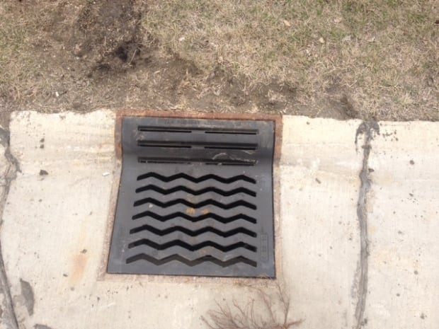 Repaired sewer grate