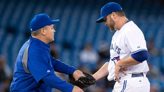 Toronto Blue Jays manager John Gibbons in a game last month greets pitcher Mark Buehrle, who has been responsible for six of the club's 17 wins.