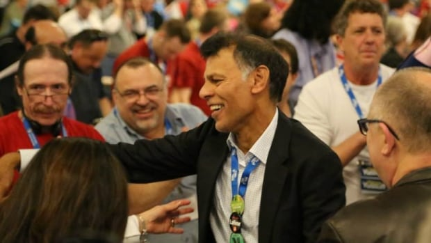 Hassan Yussuff, centre, is set to become the new president of the Canadian Labour Congress after narrowly winning a presidential vote at the union's convention in Montreal on Thursday.