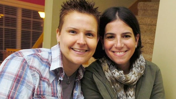 Amy Sandler, right, and her wife, Niki Quasney, are seen in a 2011 file photo. U.S. District Judge Richard Young's injunction extends an April 10 temporary restraining order requiring the state to list Sandler as Quasney's spouse after Quasney dies of cancer. It applies only to them, not to other gay couples who were legally wed elsewhere and are also seeking to have Indiana recognize their marriages.