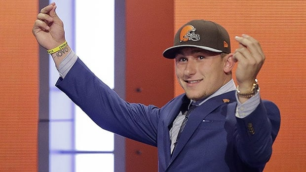 Quarterback Johnny Manziel reacts after being selected by the Cleveland Browns as the 22nd pick in the NFL draft.