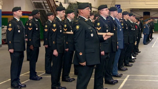 Soldiers stand during a ceremony to mark a National Day of Honour in Calgary.