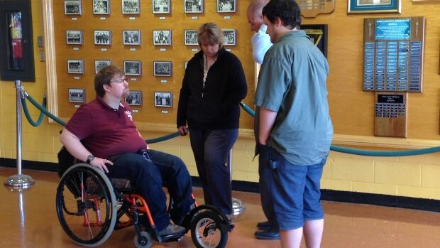 Jaret Richard is more mobile thanks the additional wheel on his wheelchair.