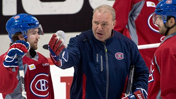 Habs coach Michel Therrien, centre, instructs David Desharnais, left, and Max Pacioretty, right, at practice.