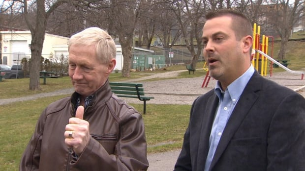 St. John's Mayor Dennis O'Keefe, flanked by Ward 2 Coun. Jonathan Galgay, gives a thumbs-up to the idea of opening up Bennett's Creek, which runs through and under Victoria Park.