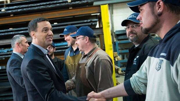 Ontario PC Leader Tim Hudak greets employees at Ranfar Steel Ltd. while campaigning in Courtice, Ont. on Saturday.