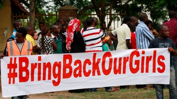 People attend a rally on Saturday calling on the government to rescue the school girls kidnapped from the Chibok Government secondary school, in Abuja, Nigeria.