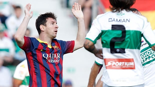 Barcelona's Lionel Messi from Argentina reacts after failing to score against Elche during a Spanish La Liga soccer match at the Martinez Valero stadium in Elche, Spain, on Sunday.