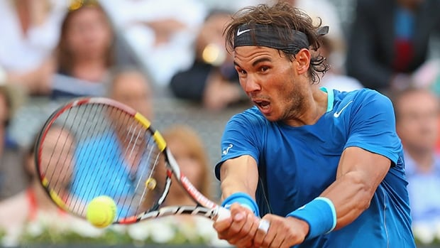 Rafael Nadal plays a backhand against Kei Nishikori in their final match at the Madrid Open on Sunday in Madrid, Spain.