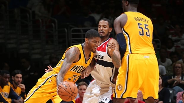 The Pacers' Paul George (24 ) handles the ball against the Wizards in Game 4 of the NBA Eastern Conference semifinal on Sunday in Washington, DC. George scored a career playoff-high 39 points and added 12 rebounds to lead Indiana to a 95-92 victory.