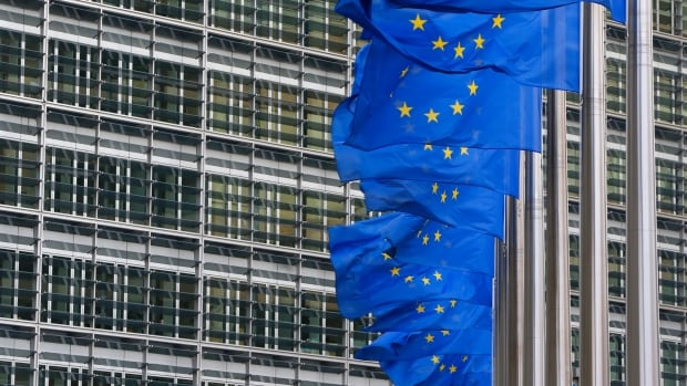 European Union foreign ministers have added 13 people and for the first time, two businesses, to its visa ban and asset freeze list over Ukraine, officials said Monday.