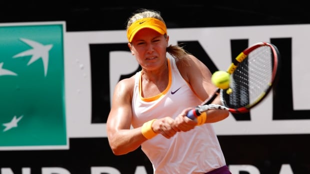 Canada's Eugenie Bouchard returns the ball to Italy's Francesca Schiavone at the Italian Open on Monday in Rome.