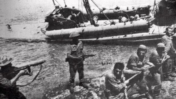 Turkish troops, on July 20, 1974, pull ashore a Greek Cypriot torpedo boat damaged during fighting in Kyrenia on the day Turkey invaded and occupied the northern third of Cyprus.