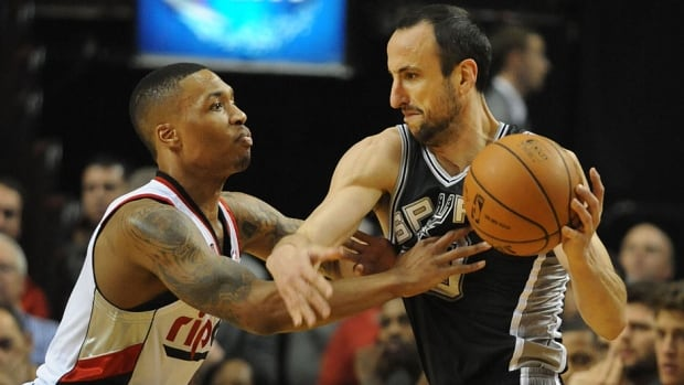 Damian Lillard, left, of the Portland Trail Blazers reaches in on the Spurs' Manu Ginobili in the first quarter of Game 4 of the Western Conference semifinals on Monday night. Lillard was also a force offensively, scoring 25 points in a 103-92 Trail Blazers victory.