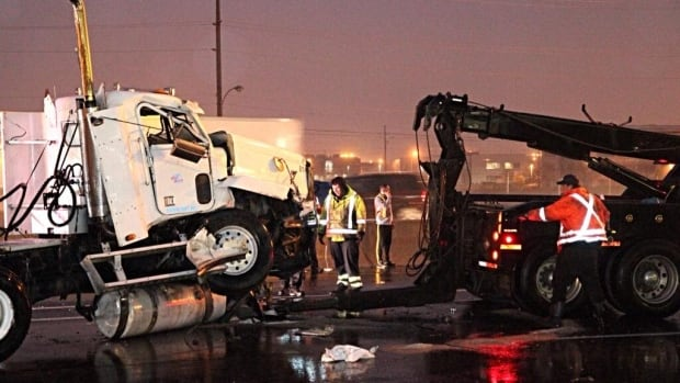 A crash involving two tractor-trailers in wet conditions closed the westbound QEW to traffic shortly after 5:30 a.m. Tuesday.