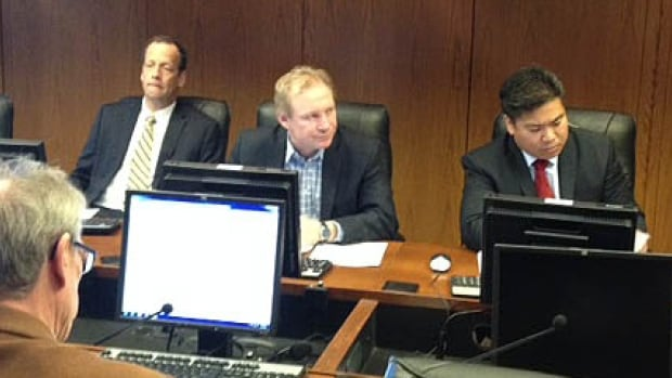 Coun. Thomas Steen (centre) listens in at a meeting of the Property and Planning
