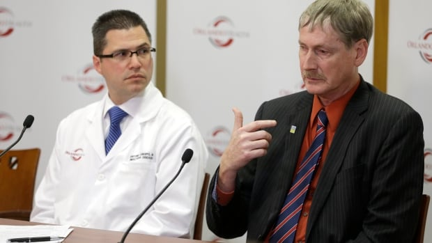 Dr. Kevin Sherin, right, health officer for the Florida Department of Health in Orange County speaks as Dr. Antonio Crespo, left, the chief quality officer at Dr. P. Phillips Hospital, gives an update about a  44-year-old MERS patient.