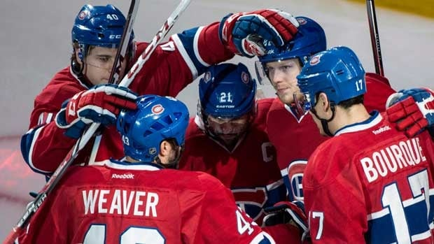 Nathan Beaulieu, top left, gathers around  Montreal teammates to celebrate during Game 6.