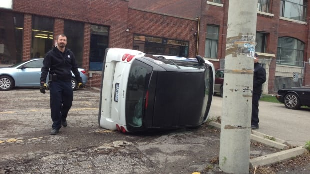 A group tipped this SmartCar in the Portland and Wellington area on Tuesday morning.
