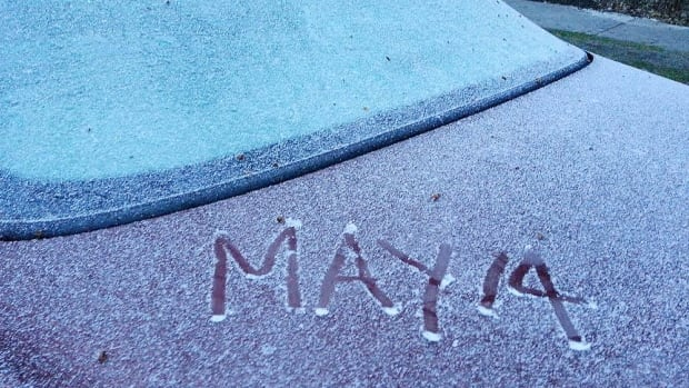 Snow covers a car in Winnipeg on May 14. Yes . . . May 14.