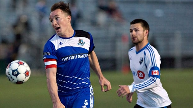 Albert Watson (5) of FC Edmonton is pursued by Jack McInerney in a 2-1 first-leg victory over the visiting Impact on May 7.