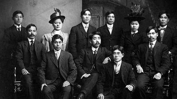 The Chinese-Canadian community was subject to discriminatory policies from the late 1800s to 1947. This historic portrait of Chinese men and women in Vancouver, is part of the UBC archives collection.