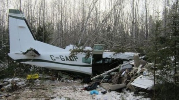 Investigators from the federal Transportation Safety Board took this photograph from the scene of the fatal plane crash in Snow Lake.
